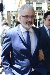 John Jarratt leaves the Downing Centre District Court in December 2018.