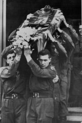 Pallbearers form the 3rd Battalion, R.A.R., carry the coffin of National Serviceman Private Errol Wayne Noack from Bethlehem Lutheran Church in Adelaide on June 2, 1960.