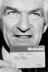 Bob Hawke in October 1983 with one of the first Medicare cards.