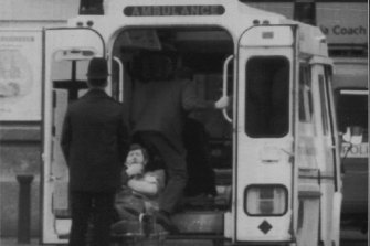 An injured traveller is stretchered into an ambulance at London's Victoria Station following the blast.