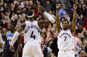 Kyle Lowry and Rondae Hollis-Jefferson celebrate their comeback win.