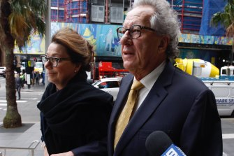 Actor Geoffrey Rush arrives at court on Tuesday with his wife Jane Menelaus.