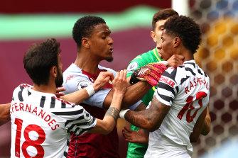 Villa's Ezri Konsa and United's Marcus Rashford almost come to blows.