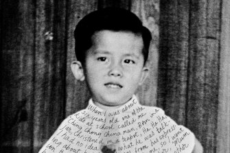 Childhood photo of William Yang, which he inscribed for his 1999 show 'Sadness'.