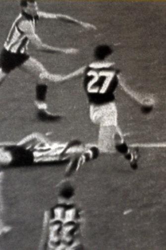 Barry Breen kicks the winning point.