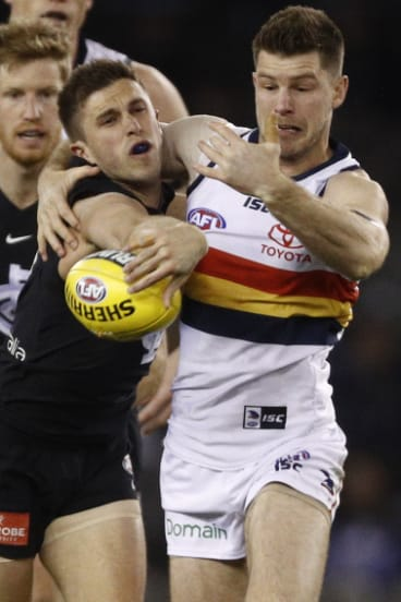 Former teammates Marc Murphy (left) and Bryce Gibbs battle for the ball at Etihad Stadium.