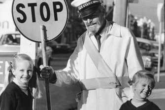 School crossing supervisor Theo Miller on Burwood Road in Hawthorn, 1979.