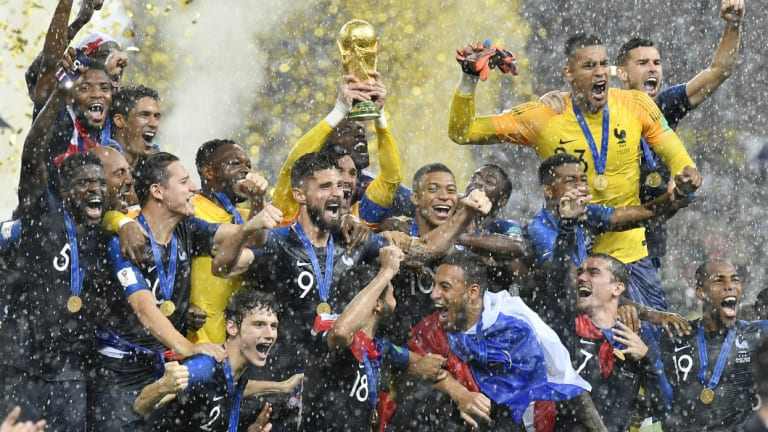 Long way to fall: Hugo Lloris lifts the World Cup trophy in July.