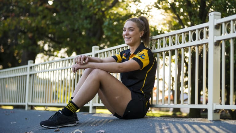 Hannah Dunn is one of the faces of AFL Canberra's booming women's competitions.