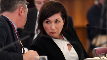 Queensland Minister for Environment, Great Barrier Reef, Science and the Arts, Leeanne Enoch (right) listens to advice from Jamie Merrick, the Director-General of the Department of Environment and Science, during a budget estimates committee hearing at Parliament House in Brisbane.