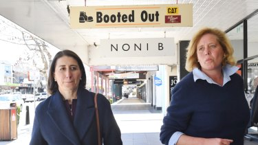 Premier Gladys Berejiklian and her Liberal candidate Julia Ham walk the streets of Wagga Wagga on Friday.