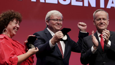 Opposition Leader Bill Shorten presents Therese Rein and former prime minister Kevin Rudd with lifetime membership at the Australian Labor Party national conference in Adelaide on Wednesday.