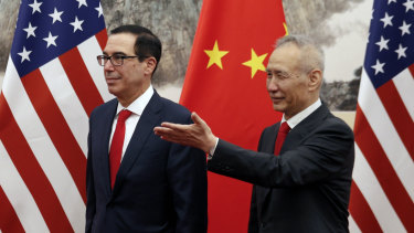 Chinese Vice-Premier Liu He shows the way to US Treasury Secretary Steven Mnuchin during their meeting at the Diaoyutai State Guesthouse in Beijing in May.