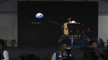 Animated graphics of Chandrayaan-2 landing module are displayed on a screen at a media centre set up to celebrate the landing, but it disappointed.
