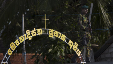 A Sri Lankan special task force officer stands guard in Negombo in the aftermath of the Easter Sunday attacks.