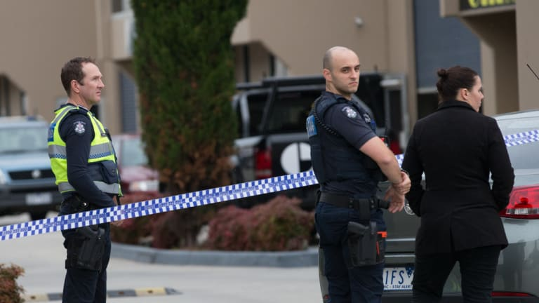 Police at the scene of the Braeside factory where Dean McGrath's body was found in 2017.