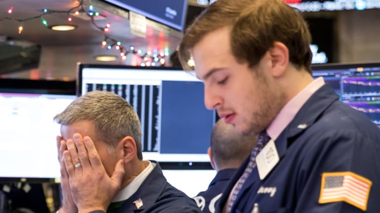 'Boom, we puke': Traders on the floor of the New York Stock Exchange.