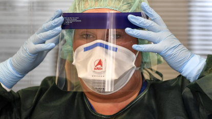 In '$2 raincoats' on virus front line, medics call for action on PPE