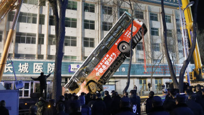 Sinkhole swallows bus in China, leaving several dead and missing