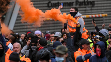 Protesters set off flares in the city on Tuesday in the second day of demonstrations.