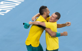 Kyrgios and Hewitt embrace after victory over Team GB in the ATP Cup in Sydney.