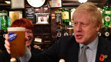 Something to cheer about: British Prime Minister Boris Johnson raises a pint of beer on the campaign trail.