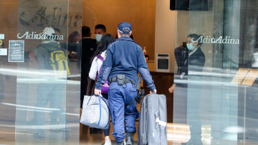Returning travellers have been put into enforced hotel quarantine for two weeks, with the states picking up the bill.