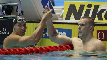 Caeleb Dressel (left) and Kyle Chalmers after their epic 100m freestyle final in South Korea.