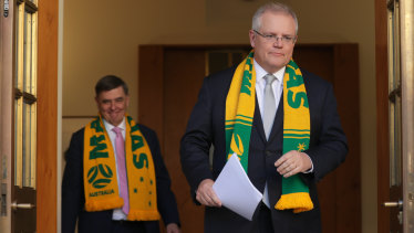 Chief Medical Officer Professor Brendan Murphy and Prime Minister Scott Morrison. No prizes for guessing the team they will be supporting at the 2023 Women's Soccer World Cup.