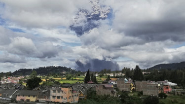 Mount Sinabung spews volcanic materials into the air as it erupts, in Karo, North Sumatra, Indonesia, on Monday.