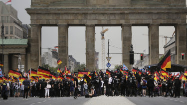 AfD supporters wave flags in front of the Brandenburg Gate in Berlin, Germany last May.