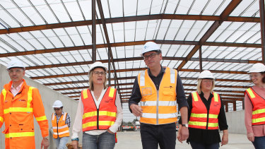 Victorian Premier Daniel Andrews and Transport Minister Jacinta Allan (second left) tour the West Gate Tunnel site.