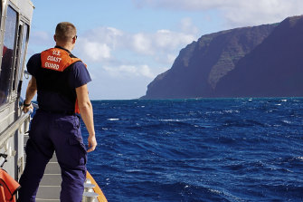 A US Coast Guard cutter moves towards the Na Pali coast during the search for the victims of a helicopter crash on Friday.