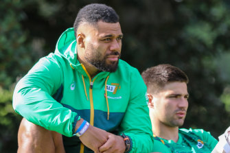 Samu Kerevi and Jack Maddocks watch on from the sidelines of Australians sevens training.
