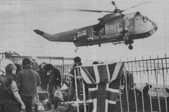 A British Royal Navy helicopter lifts off with some of the evacuees.