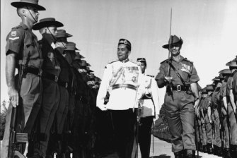 Troops of the 4th Battalion, Royal Australian Regiment, are inspected by the Chief of the Malaysian armed forces.