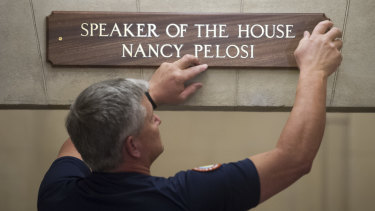 The sign at the office suite of House Speaker Nancy Pelosi is installed on Capitol Hill in Washington.