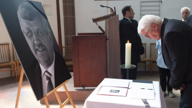 """Federal President Frank-Walter Steinmeier bows his head at the multi-religious peace service """"Peace needs courage"""" after signing a condolence book for Walter Luebcke last month."""