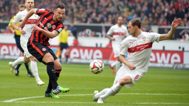 Stuttgart's Georg Niedermeier (right) defends against Frankfurt's Haris Seferovic in the Bundesliga.