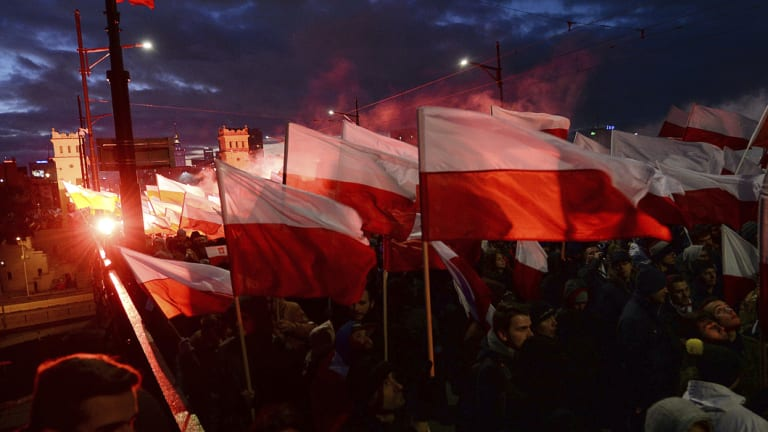 Demonstrators burn flares and wave Polish flags during the annual march in 2017.