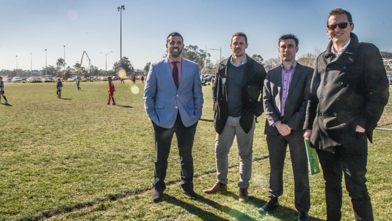 Canberra A-League bid team members Michael Caggiano, Adam Castle, Aaron Walker and Bede Gahan check out some future soccer stars at the Kanga Cup.