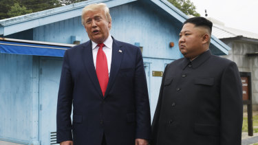 President Donald Trump meets North Korean leader Kim Jong-un at the border village of Panmunjom in the Demilitarised Zone, South Korea on Sunday.