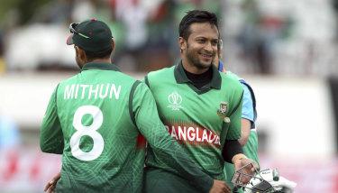 Shakib Al Hasan, right, and Liton Das celebrate the win over the West Indies.