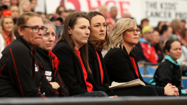 NSW Swifts coach Briony Akle (right) has been left in isolation in Adelaide after being identified as a close contact.