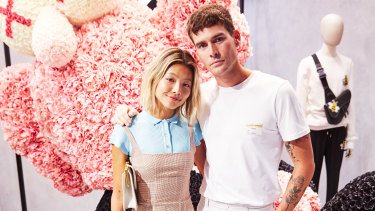 Genetically-blessed couple Yan Yan Chan and Nathan Jolliffe pose alongside the Dior figurine.