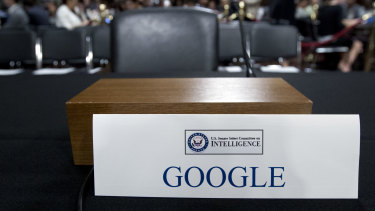 An empty chair reserved for Google's parent Alphabet, which refused to send its top executive.