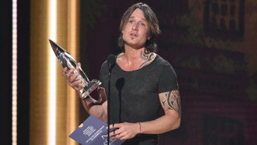 Keith Urban accepts the award for entertainer of the year at the 52nd annual CMA Awards in November.