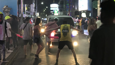 Young, drunk Australian revellers stop traffic on Jalan Legian, Kuta, outside some of the strip's many night clubs.