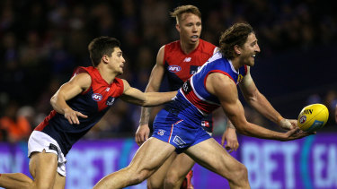 Dishing it off: Marcus Bontempelli slips away from Demon Jay Lockhart.