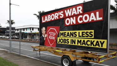 A billboard parked at the pro-Adani rally in Mackay featured a misleading, cropped photograph of Bill Shorten.